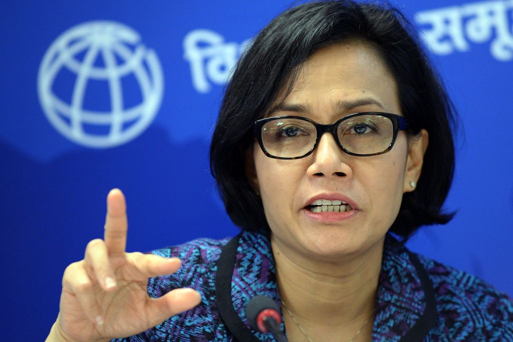 """Indonesian World Bank Managing Director and Chief Operations Officer Sri Mulyani Indrawati speaks during the launch of a World Bank report in the Indian capital New Delhi on September 24, 2015. The report titled """"Leveraging Urbanisation in South Asia: Managing Spatial Transformation for Prosperity and Livability,"""" examines how India and South Asian nations can capitalise economically on the opportunities urbanisation provides.  AFP PHOTO / PRAKASH SINGH"""